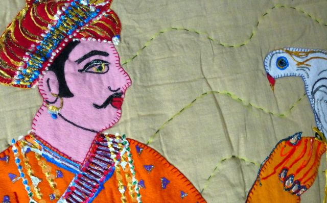 Embroidery of man with a bird.