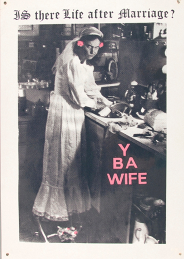 Woman standing at kitchen sink.